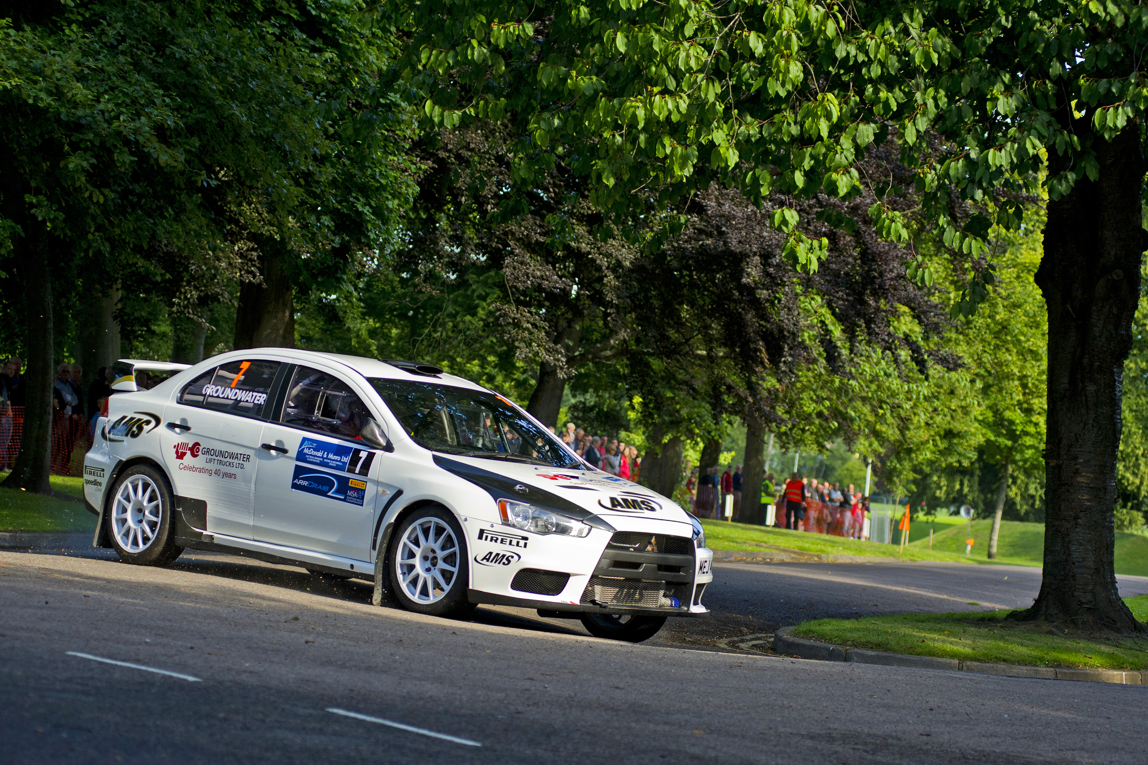 Speyside Stages Rally 2015. Elgin's Sean Donnelly co-driving Stonehaven's Barry Groundwater in their Mitsubishi Lancer Evo 10. Picture: Daniel Forsyth. Image No.029973